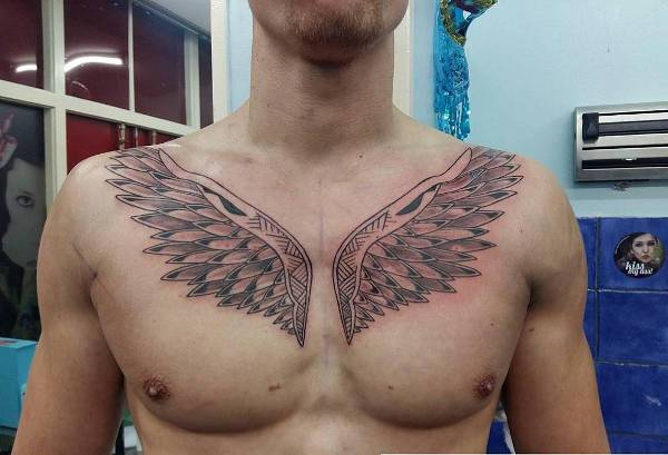 Above Chest Wings Tattoo