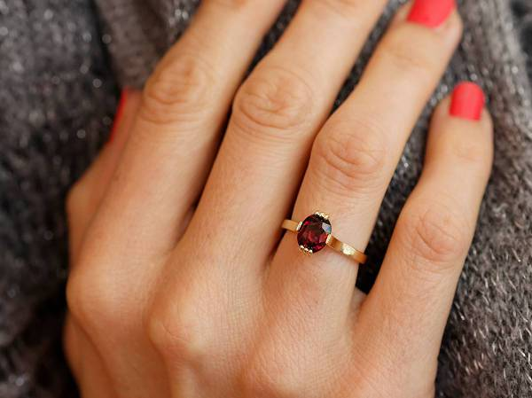 red garnet oval solitaire engagement ring