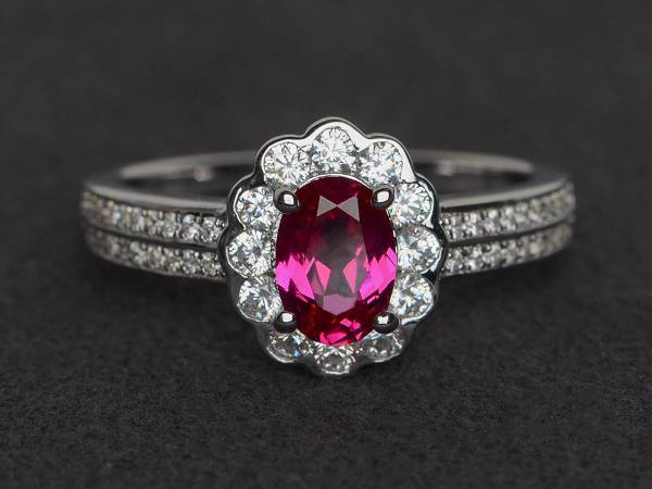 oval ruby halo engagement ring