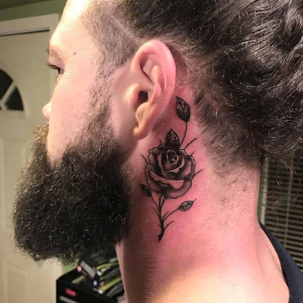small rose tattoo for men on neck