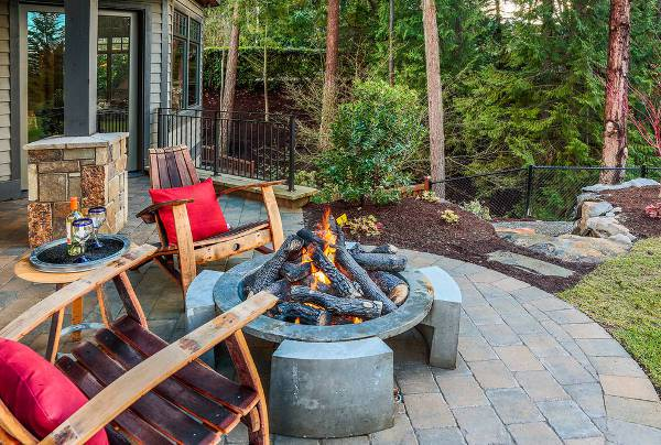 rustic patio chair with red cushion