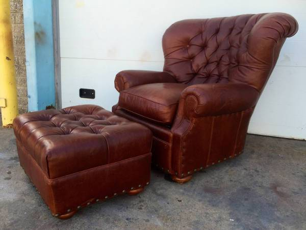 tufted disstressed leather chair