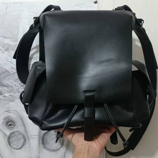 black leather flap backpack