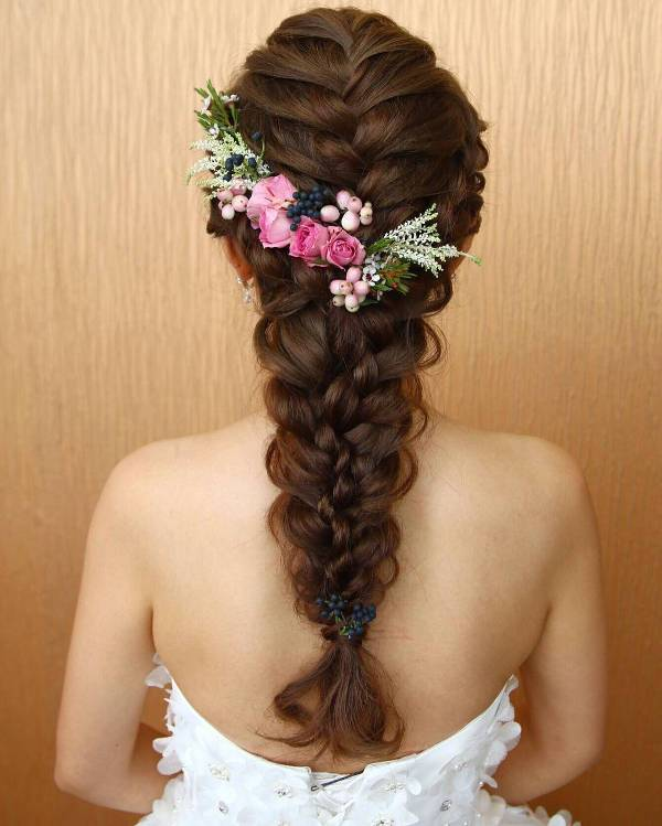 braided bridal hairstyle with flowers