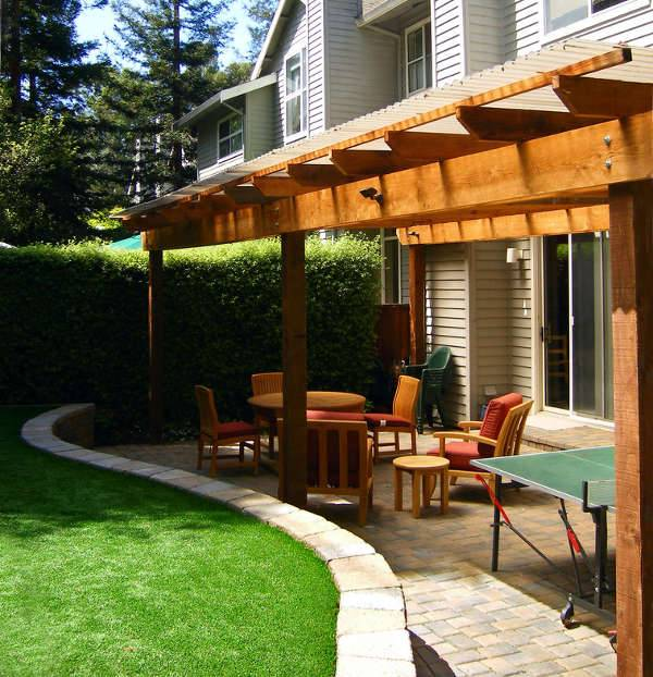 sloped backyard patio idea