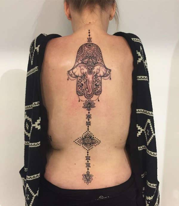 mandala spine tattoo