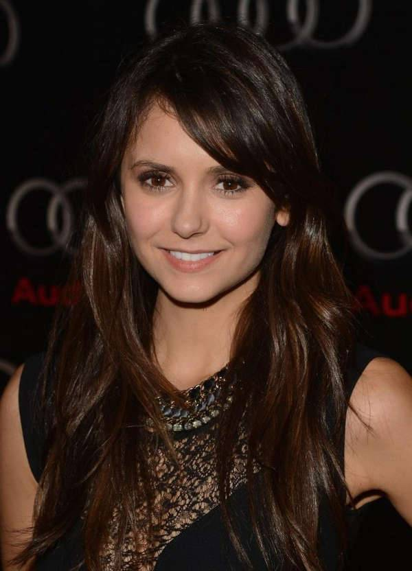 nina dobrev layered side swept bangs hairstyle