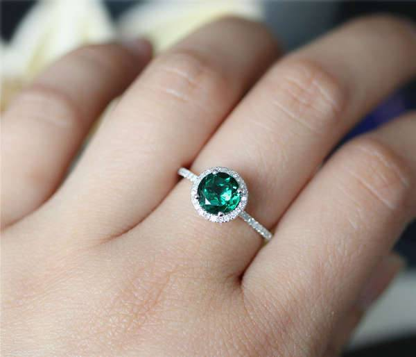 round cut emerald engagement ring